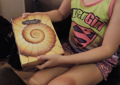 Esabella holding the Oracle of Shoes Wisdom Cards Box